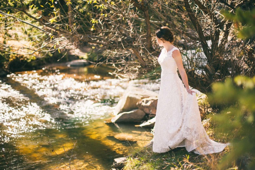 028 Evergreen Lake House Wedding Photographer bride by the river