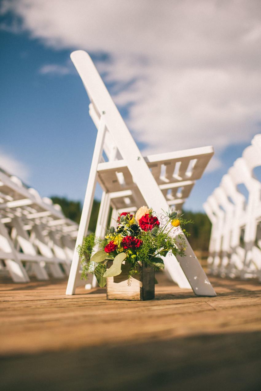 035 Evergreen Lake House Wedding Photographer asile flowers beet and yarrow