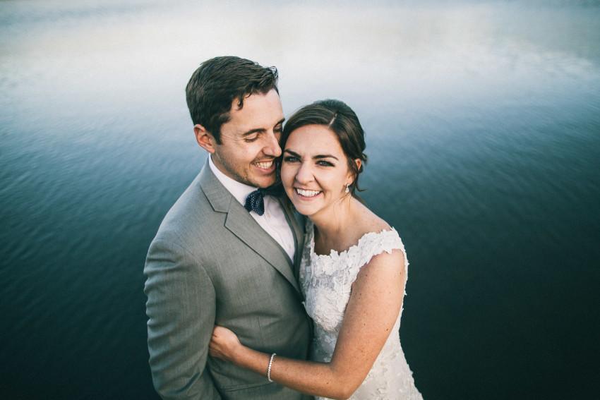 053 Evergreen Lake House Wedding Photographer happy bride and groom lake
