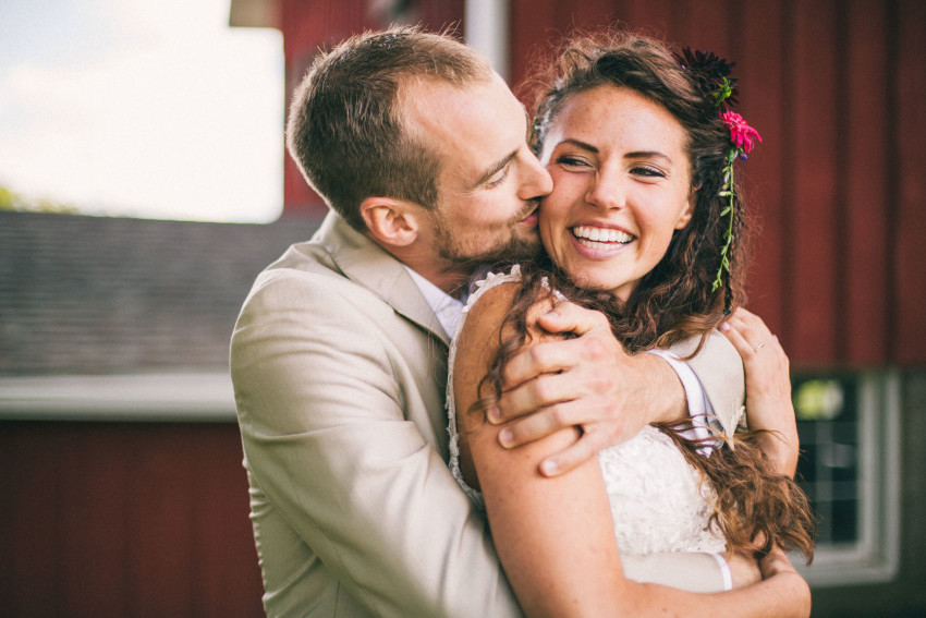 064 Mukwonago Milwaukee WI Barn DIY Laid-back Close up of Bride Groom Portrait Kissing Cheeks Danny Andrea