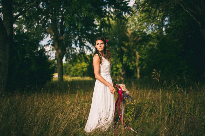 065 Mukwonago Milwaukee WI Barn DIY Laid-back Beautiful Landscape photo of bride in grass wedding Danny Andrea