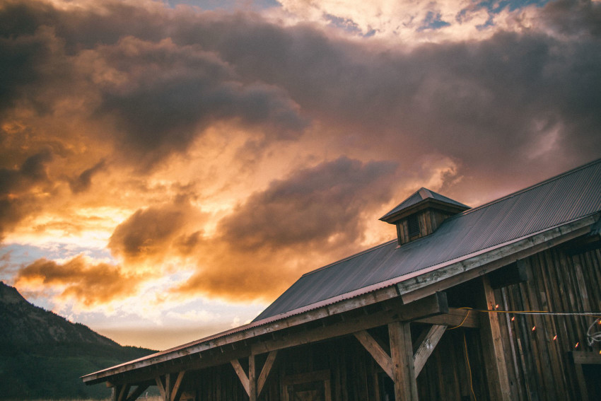 082 Crested Butte CO Private Ranch Wedding Local Foodie Stormy Rain Unique Initimate Burning of Sage Ceremony Barn Live Band Marquee Lights Stars Night Sky